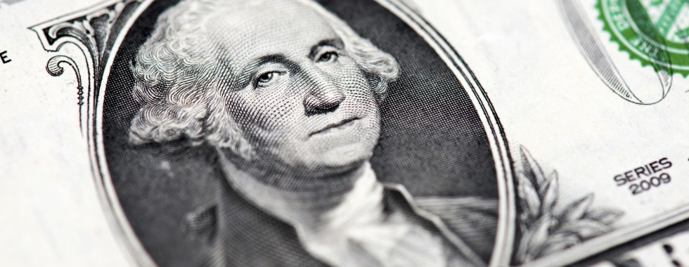 Macro of image the face of George Washington on the One American Dollar Bill. Selective focus.