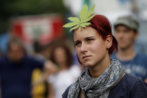 "BERLIN - AUGUST 07: A young woman wearing a paper marijuana leaf on her head marches in support of the legalization of marijuana in Germany during the annual Hemp Parade, or ""Hanfparade"", on August 7, 2010 in Berlin, Germany. The consumption of cannabis in Germany is legal, though all other aspects, including growing, importing and selling it, are not. However, since the introduction of a new law in 2009, the sale and possession of marijuana for licenced medicinal use is legal. (Photo by Sean Gallup/Getty Images)"